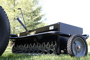 combination aerator and spreader