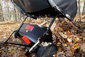 lawn sweeper dumping fall leaves