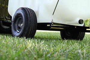 sprayer wheels on grassy lawn
