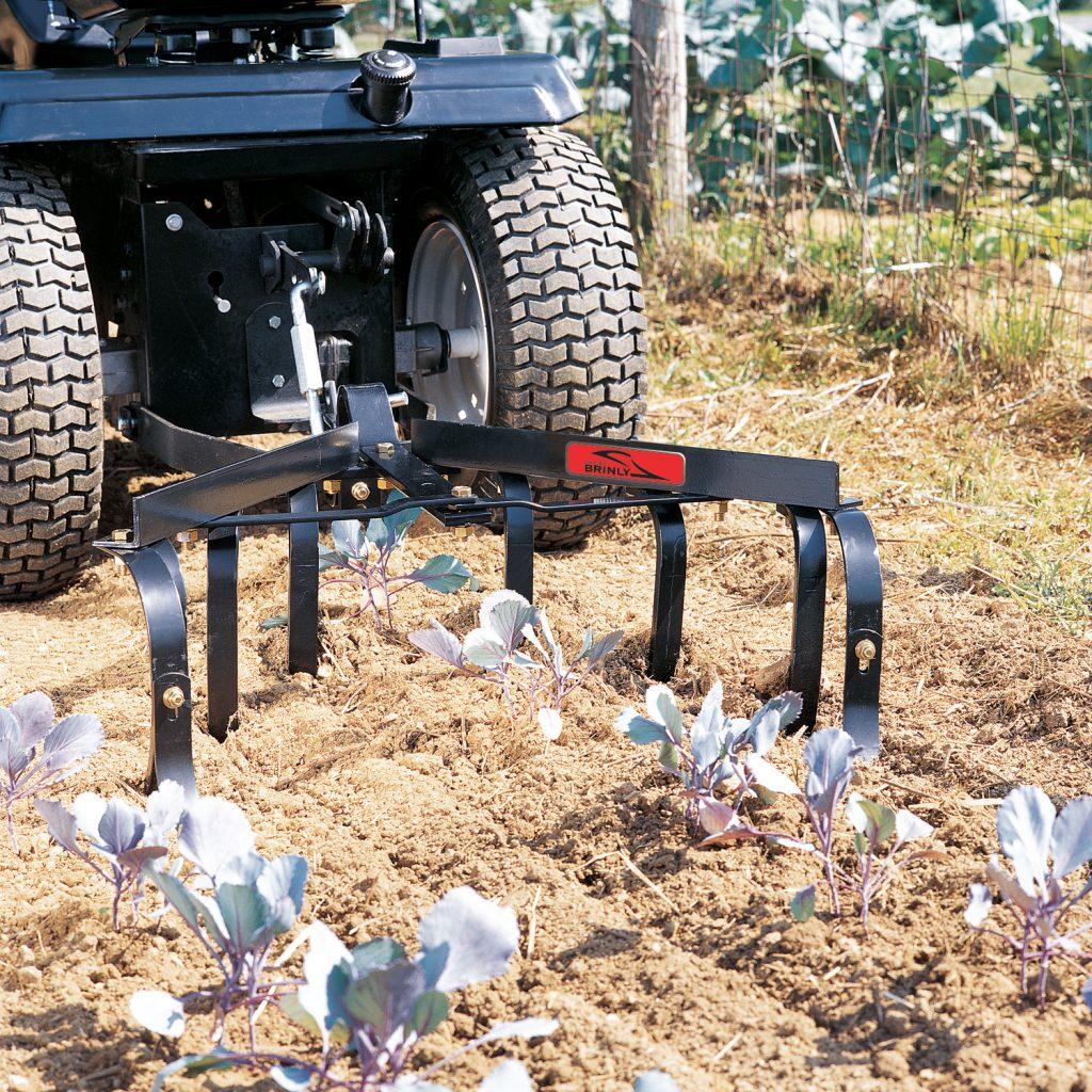 brinly cultivator breaking garden ground