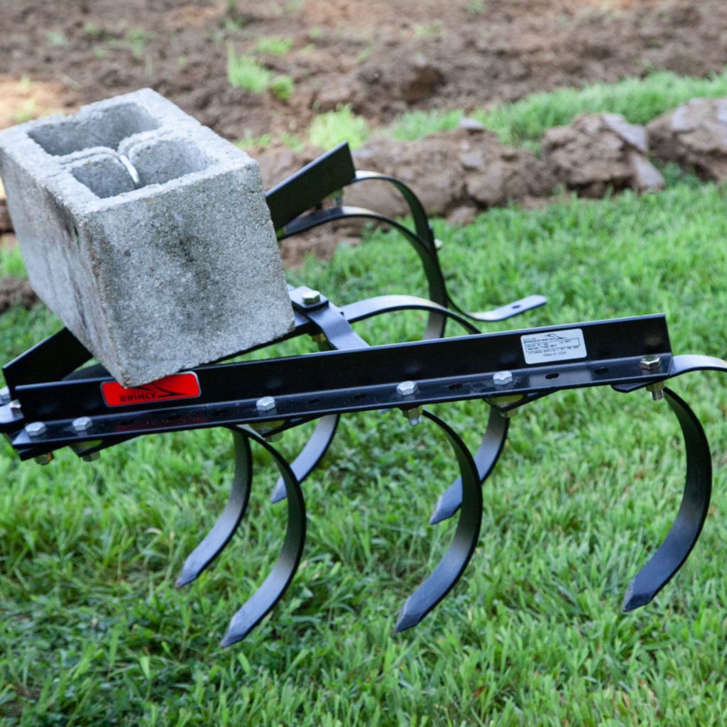 raising cultivator with tractor sleeve hitch