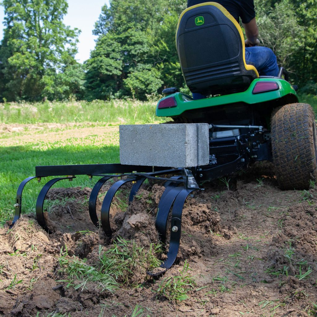 brinly steel cultivator breaking farm ground