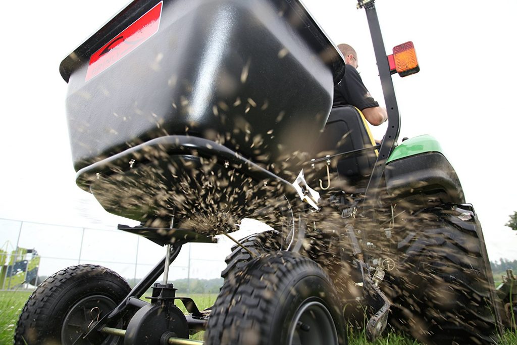 tow spreader spreading grass seed