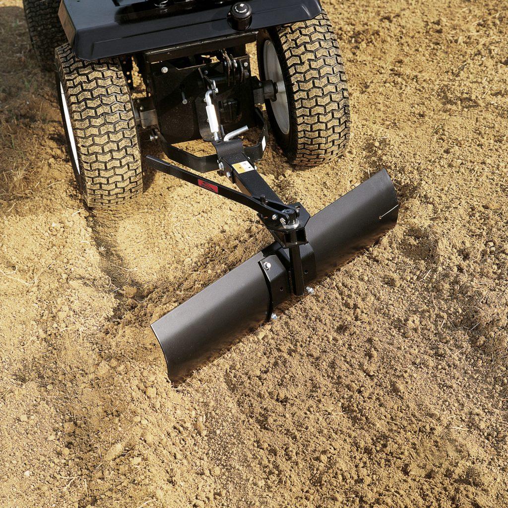 rear blade pulling dirt