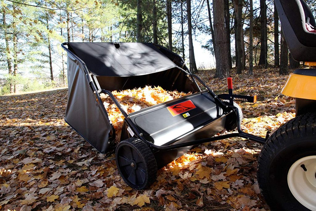 brinly lawn sweeper full of fall leaves