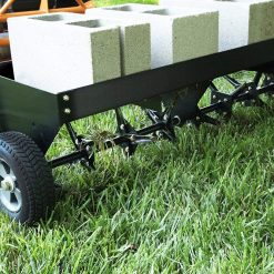 cement blocks on aerator weight tray
