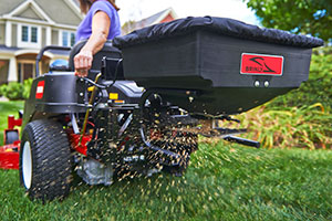 close up ztr spreader toro timecutter spreading seed