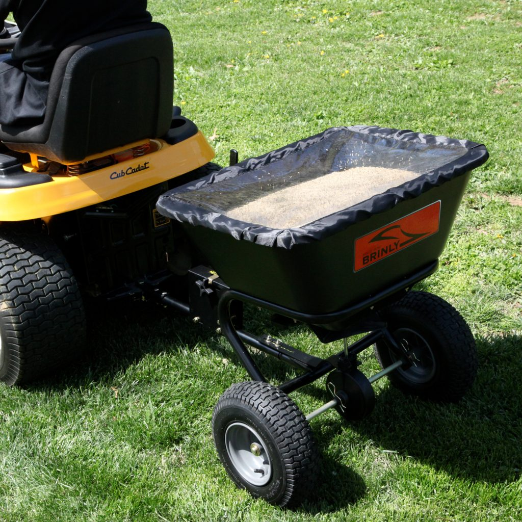 spreader with hopper full of seed