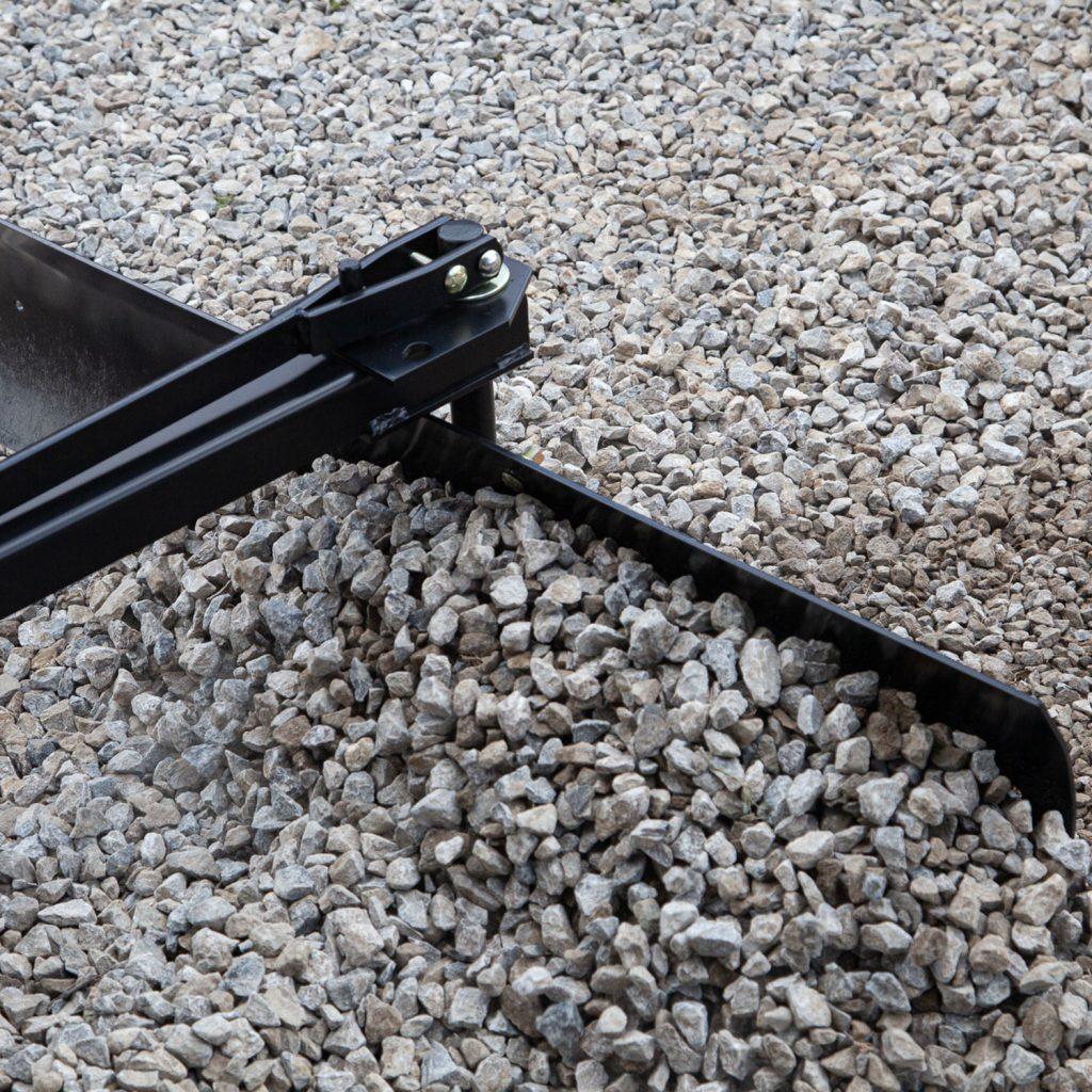 rear blade pulling gravel rocks