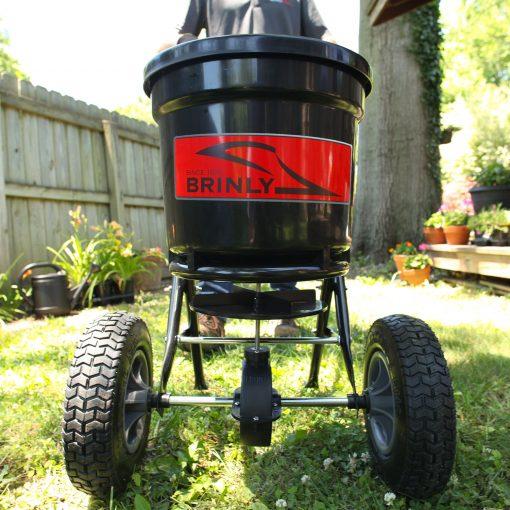 brinly push spreader 50lb hopper outdoors