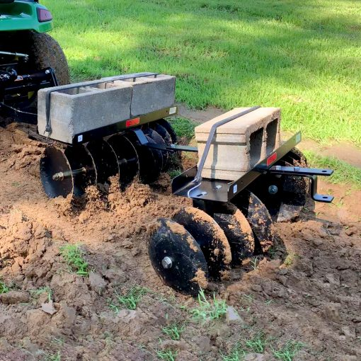two brinly disc harrows in tandem discing ground
