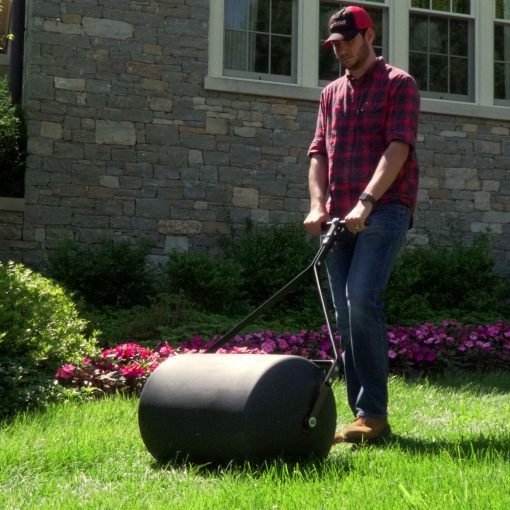 Brinly 28 gallon roller pushed in the yard