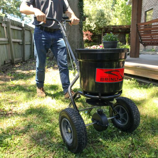 brinly push spreader pushed in the lawn