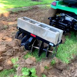 brinly tractor disc harrow with cement blocks