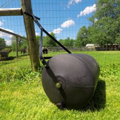 Brinly 28 gallon roller against fence outdoors