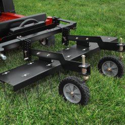 frount mount ztr dethatcher on mower outdoors