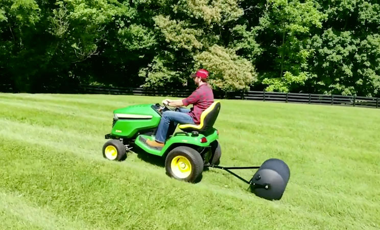 28 gallon sod roller being towed in lawn