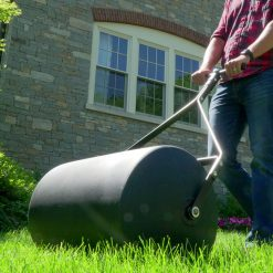 Brinly 28 gallon push tow roller outdoors